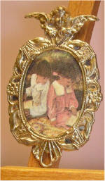 Brother & Sister reading in Gold Oval w/Cherub Frame