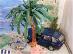 Beach Scene by Grace Car under palm tree
